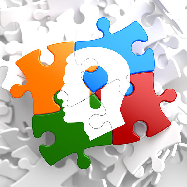 Psychological Concept - Profile of Head with a Keyhole Located on Multicolor Puzzle.