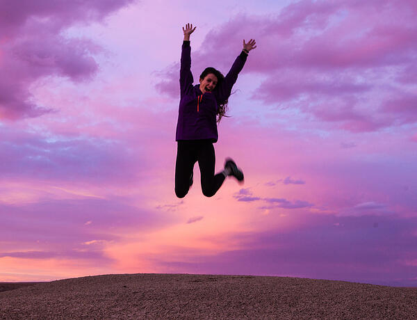 energy boost woman jumping up in the air